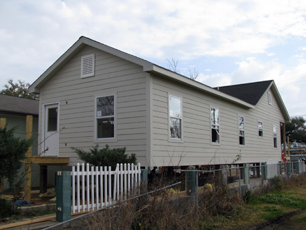 The windows and siding are installed on the southwest corner.